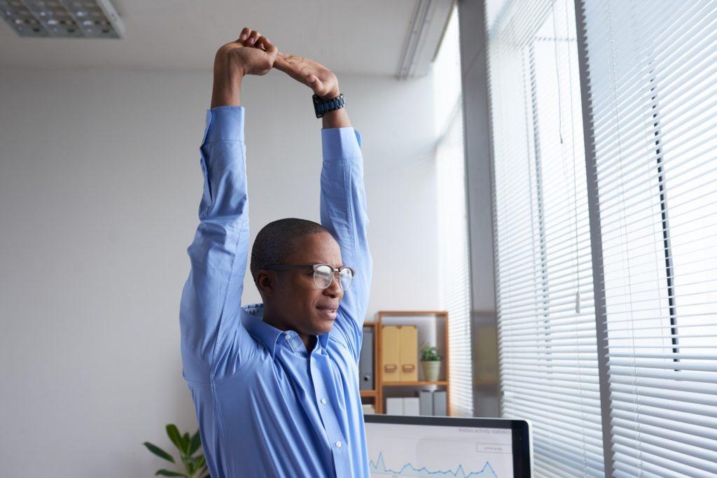 Man stretching at work